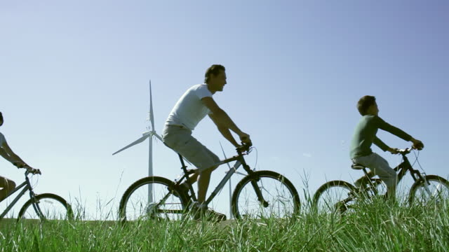 ms family cycling in wind farm / toulouse, midi-pyrenees, france - lockdown viewpoint stock videos & royalty-free footage