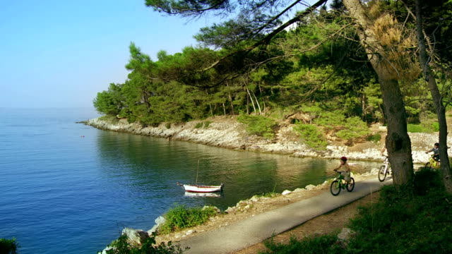 HD: Family Cycling On The Coastline Route