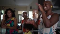 Family dancing and having fun at home