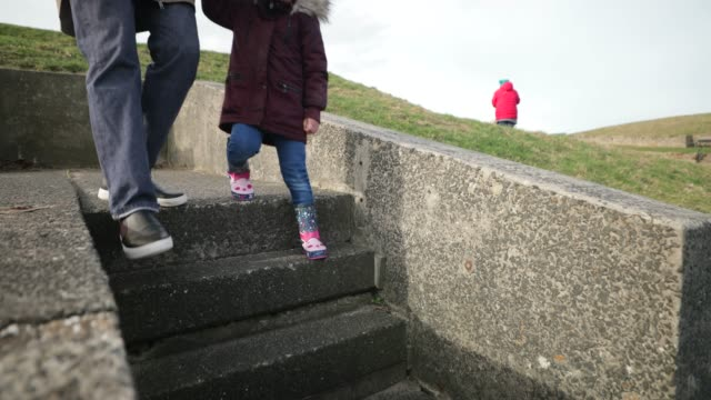 family day out at the seaside beach - whitley bay stock videos & royalty-free footage