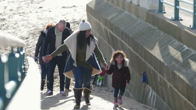 family day out at the seaside beach - holding hands stock videos & royalty-free footage