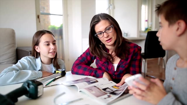 Family decides what to buy from the catalog