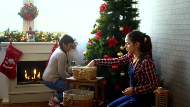 family decorate the christmas tree - family tree stock videos and b-roll footage
