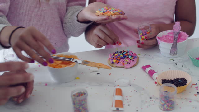 cu family decorating cookies together - family with two children stock videos & royalty-free footage