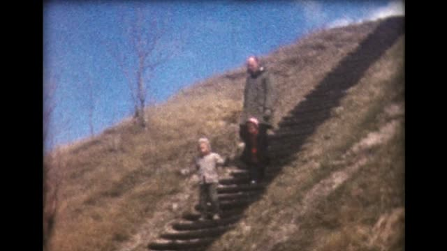 1961 family descends steep stairs - steep hill stock videos & royalty-free footage