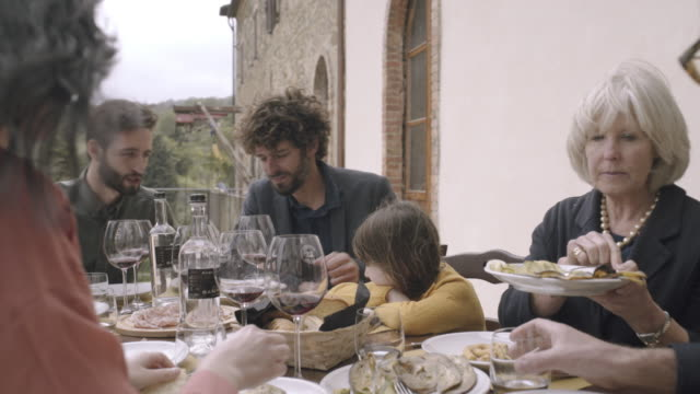 family dining and drinking outdoors on holiday - siena italy stock videos and b-roll footage