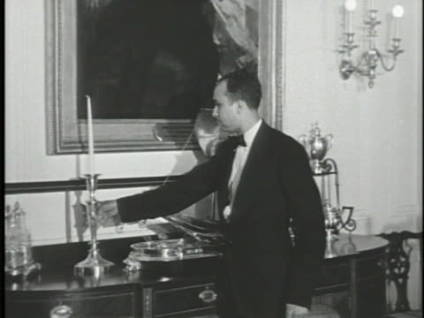 family dining room male staff member placing candles in holders on sideboard john tyler painting by george p a healy cu bottom frame information ws... - george washington painting stock videos and b-roll footage