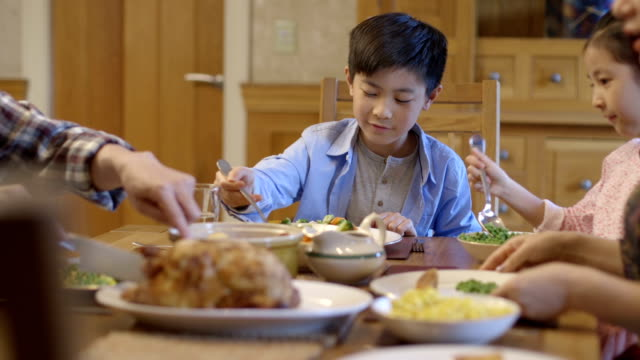 family dinner time - chinese ethnicity stock videos & royalty-free footage