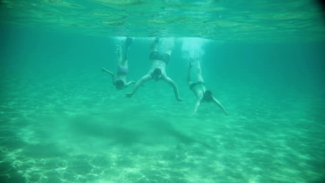 family diving underwater in sea - beach holiday stock videos & royalty-free footage