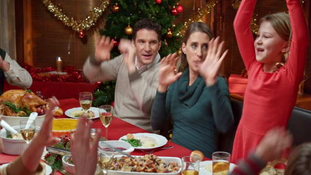 family doing a funny dance at the christmas table - tradition stock videos & royalty-free footage