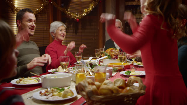 stockvideo's en b-roll-footage met family doing a funny dance at the festive table - elegantie