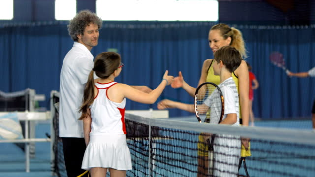 MS TU Family Doing A Team Cheer After Playing Tennis