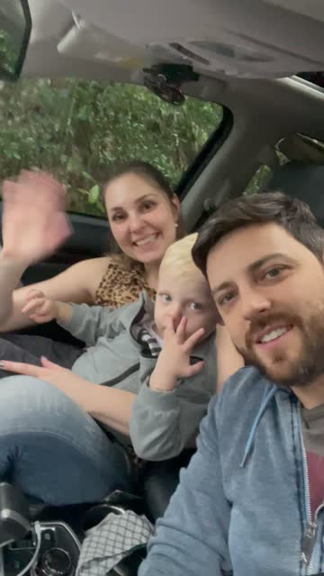 family doing a video call on smartphone in the car - mid adult stock videos & royalty-free footage