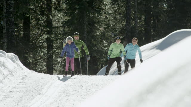 MS PAN Family doing cross country skiing in winter day / Squamish, BC, Canada