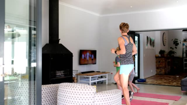 family doing some home exercising - quarantine stock videos & royalty-free footage