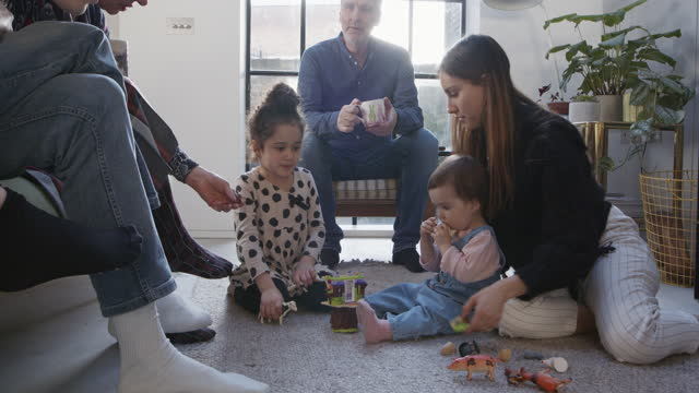 family drinking tea and relaxing in living room - toddler stock videos & royalty-free footage