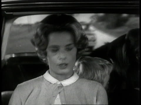 stockvideo's en b-roll-footage met 1963 montage family driving around the holiday season / united states - 1963