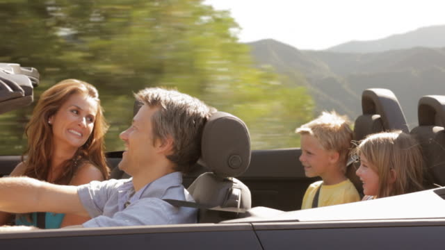 family driving in convertible car - family convertible stock videos & royalty-free footage