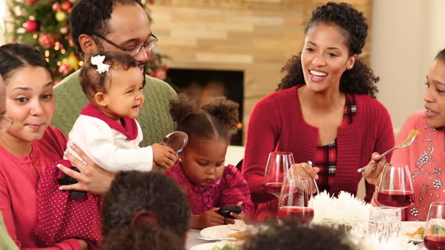 family eating a christmas meal - large family stock videos & royalty-free footage