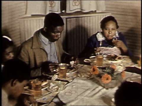 1940 montage family eating at a large table / boligee, alabama, united states - large family stock videos and b-roll footage