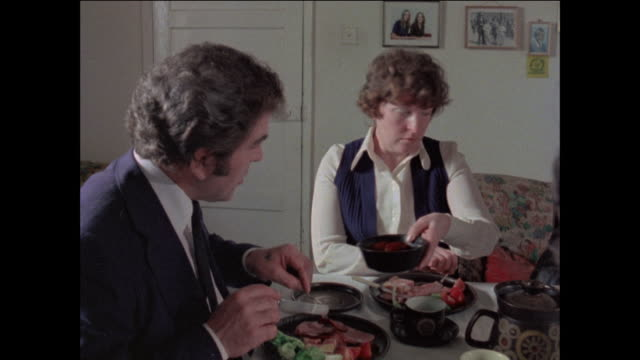 stockvideo's en b-roll-footage met montage family eating at dinner party / united kingdom - 1977