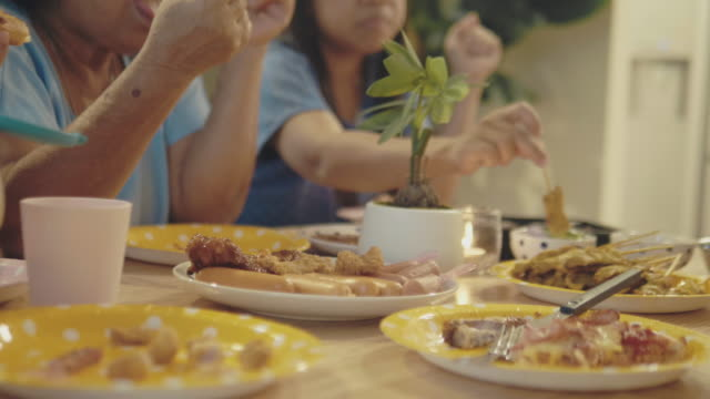 family eating at table - skewer stock videos & royalty-free footage