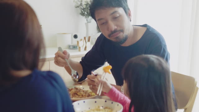 family eating breakfast at a nicely set table - orange juice stock videos & royalty-free footage