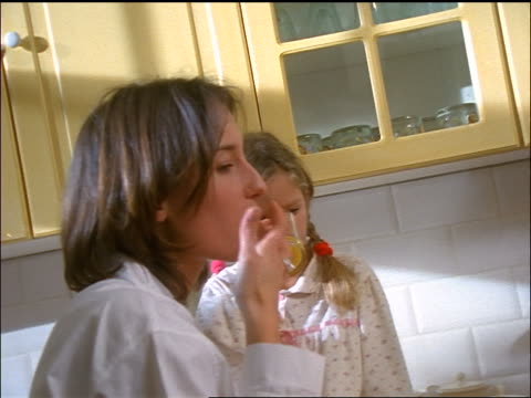 pan family eating breakfast at kitchen counter - son stock videos & royalty-free footage