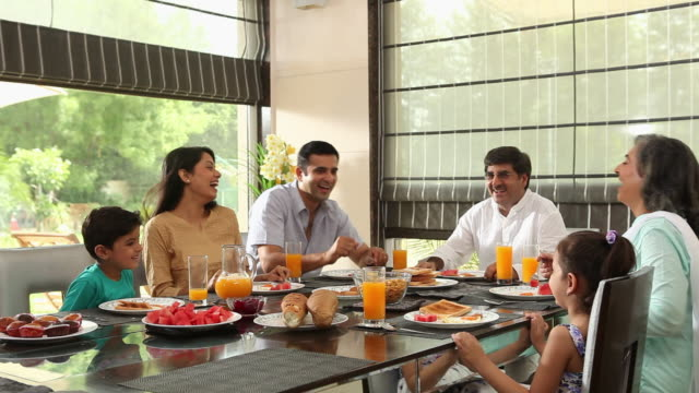 Family Eating Breakfast In A Dining Room Stock Footage ...