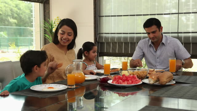 family eating breakfast in a dining room  - two parents stock videos & royalty-free footage