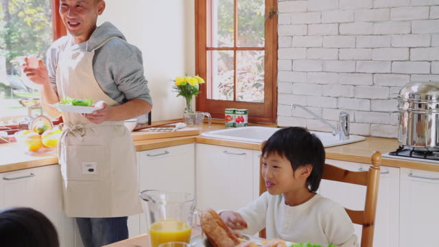 MS PAN Family eating breakfast in kitchen / Fujikawaguchiko, Yamanashi, Japan