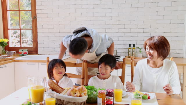 MS PAN Family eating breakfast in kitchen / Fujikawaguchiko, Yamanashi, Japan