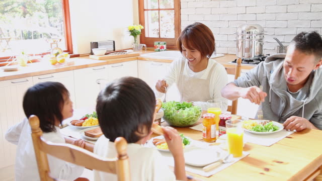 ms  family eating breakfast in kitchen / fujikawaguchiko, yamanashi, japan - short hair stock videos & royalty-free footage