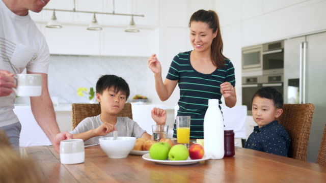family eating breakfast in the kitchen - preparation stock videos & royalty-free footage