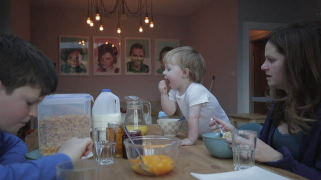 family eating breakfast together - bowl stock videos and b-roll footage