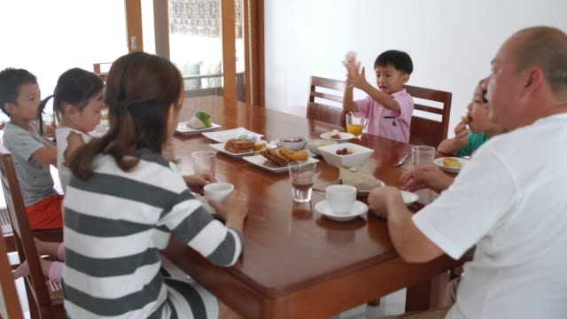 family eating breakfast together - dining table stock videos & royalty-free footage
