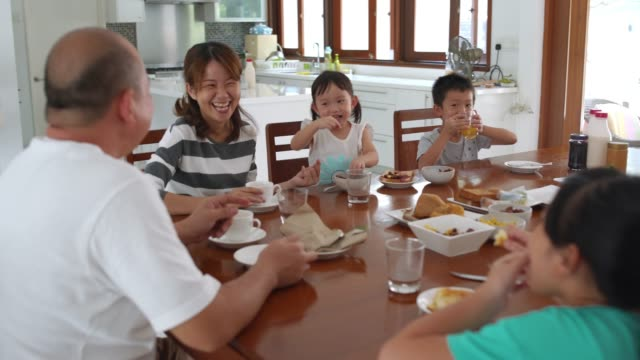 family eating breakfast together - family with four children stock videos and b-roll footage