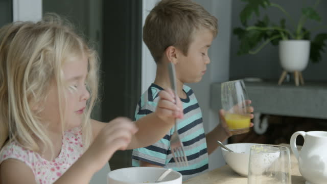 family eating breakfast - dessert stock videos & royalty-free footage