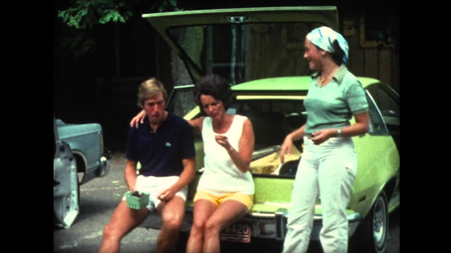 1976 family eating cherries and kicking pits - 1976 stock videos and b-roll footage