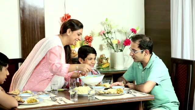 family eating dinner at home, delhi, india - meal stock videos & royalty-free footage