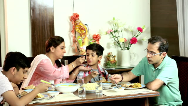 Family eating dinner at home, Delhi, India