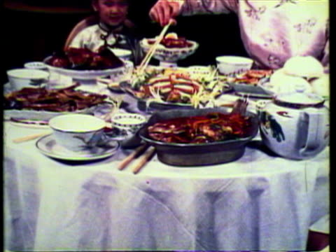 1953 ms tu pan zo family eating dinner in chinese restaurant / hong kong, china / audio - traditional clothing stock videos & royalty-free footage