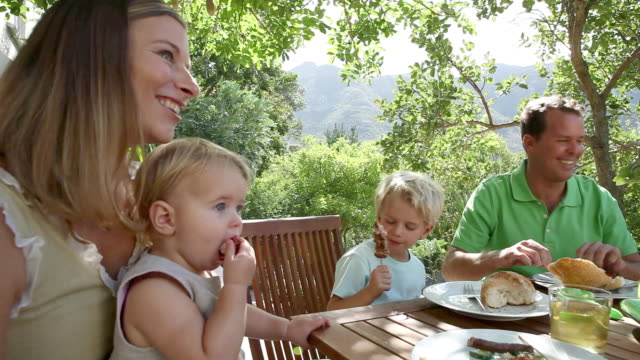 family eating lunch al fresco - meal stock videos & royalty-free footage