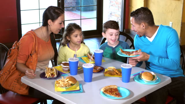 family eating lunch at amusement arcade - unhealthy eating stock videos & royalty-free footage