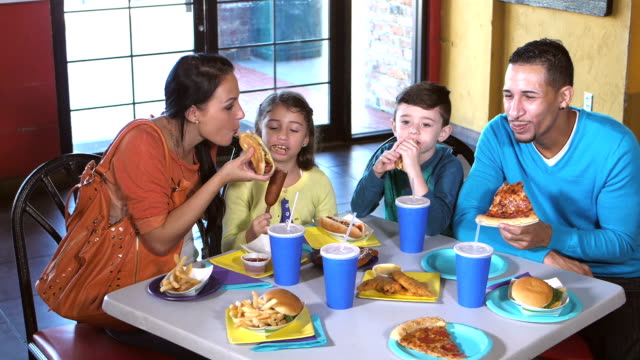 family eating lunch at amusement arcade - lunch stock videos & royalty-free footage