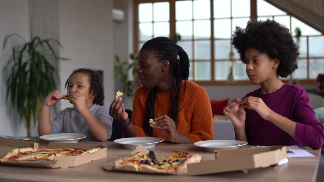 family eating pizza together at home - human age stock videos & royalty-free footage