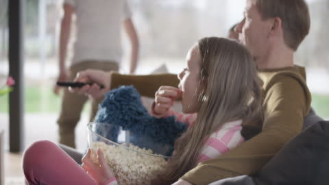 family eating popcorn and watching tv - television stock videos & royalty-free footage