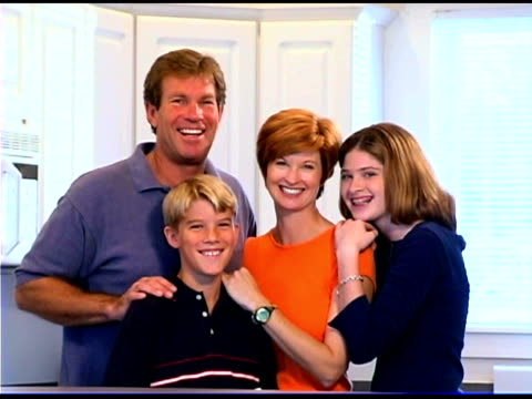 family embracing and smiling - see other clips from this shoot 1335 stock videos and b-roll footage