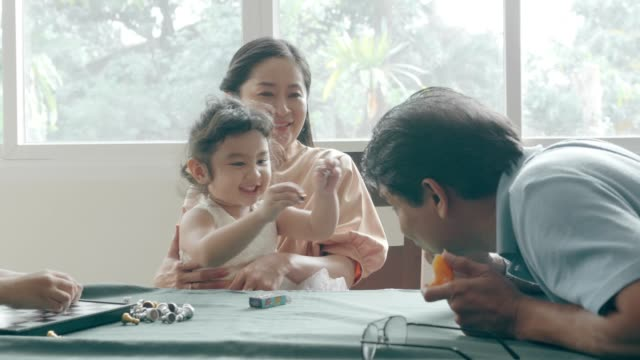 family enjoy playing checkers - thai ethnicity stock videos & royalty-free footage