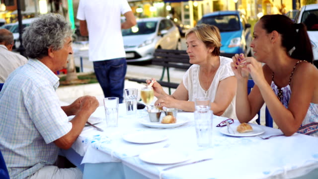 family enjoying a meal - greece stock videos & royalty-free footage